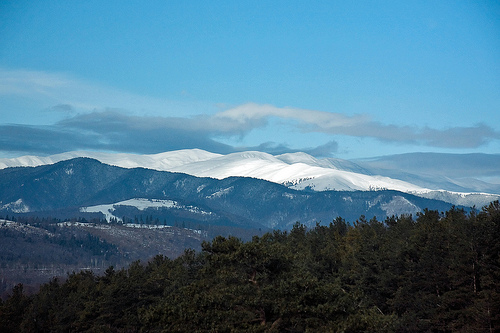 Snow covered mountain peaks on the horizon