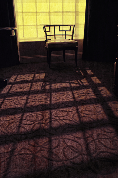 GRIGSBY_ChairAndSunlight: An empty chair in a Las Vegas hotel room tells an incredible story for me. The yellow glow from the window and the long shad