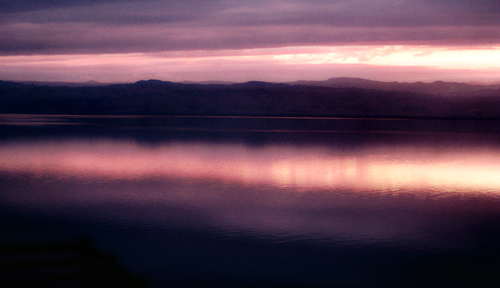 GRIGSBY_DeadSeaJordanianSide: An interesting play of light and color on the Dead Sea, as seen from the Jordanian side. The setting sun filtered throu